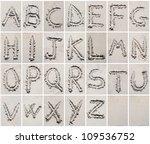 Alphabet letters writing on the sand beach