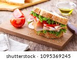 homemade sandwich with smoked... | Shutterstock . vector #1095369245