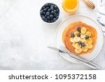 buttermilk pancakes with banana ... | Shutterstock . vector #1095372158