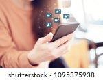 woman hands using mobile... | Shutterstock . vector #1095375938