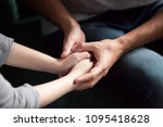 close up view of couple holding ... | Shutterstock . vector #1095418628