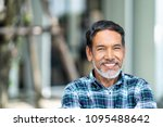 portrait of happy mature man... | Shutterstock . vector #1095488642