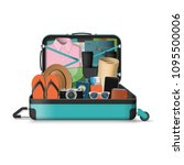opened travel suitcase full of... | Shutterstock .eps vector #1095500006