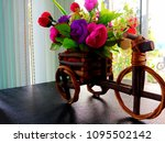 colorful flower basket to... | Shutterstock . vector #1095502142