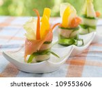 Cucumber roll with salmon, pepper, apple,  lettuce and carrot, selective focus - stock photo