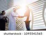 business partners hand shake in ... | Shutterstock . vector #1095541565