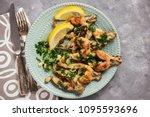 frog legs baked with garlic...   Shutterstock . vector #1095593696