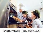 children bakers with pizza in...   Shutterstock . vector #1095596666