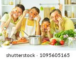 family in the kitchen  | Shutterstock . vector #1095605165