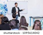 a male teacher conducts a... | Shutterstock . vector #1095614042