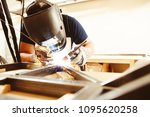 male in face mask welds with... | Shutterstock . vector #1095620258