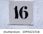 number 16  sixteen  on old... | Shutterstock . vector #1095621518