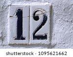 number 12  twelve  on old... | Shutterstock . vector #1095621662