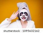a nice young girl in a bathrobe ... | Shutterstock . vector #1095632162