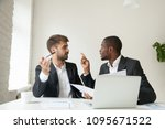 Small photo of Mad African American worker arguing with Caucasian colleague about business contract, blaming coworker for documentation mistake. Diverse businessmen disagreeing at company meeting, customer complains