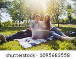 young cute couple using a... | Shutterstock . vector #1095683558