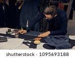 handsome bearded tailor working ... | Shutterstock . vector #1095693188