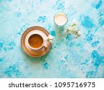 coffee and a glass of milk on a ... | Shutterstock . vector #1095716975
