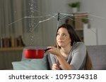 woman suffering water leaks at... | Shutterstock . vector #1095734318