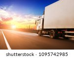 white truck driving fast and a... | Shutterstock . vector #1095742985