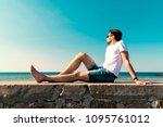 young man sitting on the... | Shutterstock . vector #1095761012