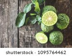 bergamot on wood background | Shutterstock . vector #1095764462