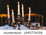 Burning candles on bronze...