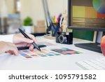 closeup graphic designer using...   Shutterstock . vector #1095791582
