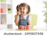 cute little child girl eating... | Shutterstock . vector #1095837458
