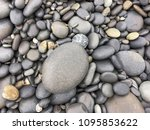 wet pebbles on tropical beach  | Shutterstock . vector #1095853622