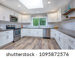 open concept kitchen with white ... | Shutterstock . vector #1095872576