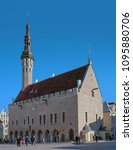 Small photo of Tallinn, Estonia - May 05, 2018: Town Hall and Town Hall Square of Tallinn, capital of Estonia. At the town hall flying the flag of Estonia and flag of the city of Tallinn.