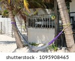 scene with a hammock and palm... | Shutterstock . vector #1095908465