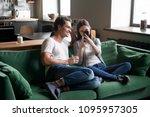 smiling millennial couple... | Shutterstock . vector #1095957305