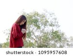 woman praying in the morning on ... | Shutterstock . vector #1095957608