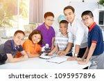 cheerful male teacher...   Shutterstock . vector #1095957896