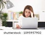 asian woman using laptop ...   Shutterstock . vector #1095957902