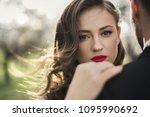 bride and groom in the green... | Shutterstock . vector #1095990692