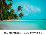 tropical sand beach with palm... | Shutterstock . vector #1095994556