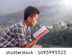 boy holding and reading the...   Shutterstock . vector #1095995525
