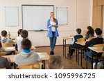 pretty teacher smiling at camera | Shutterstock . vector #1095996725