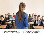 teacher asking her students a... | Shutterstock . vector #1095999008