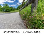 the road is in the mountains in ... | Shutterstock . vector #1096005356
