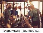 senior man at gym taking weight ... | Shutterstock . vector #1096007468