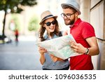 young couple looking at map...   Shutterstock . vector #1096036535
