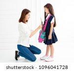 mother and daughter preparing... | Shutterstock . vector #1096041728