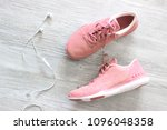 pink sneakers on the wooden... | Shutterstock . vector #1096048358
