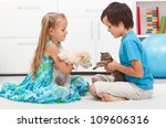 Kids playing with their pets - dog and cat - stock photo