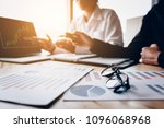 two young colleagues using a... | Shutterstock . vector #1096068968