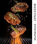 tasty beef steaks flying above... | Shutterstock . vector #1096133348